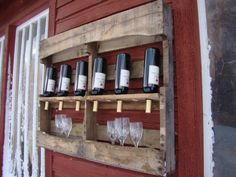 Recycled wine rack - So simple, an old wooden crate or pallet; cut out and rotate middle board with formed holes.
