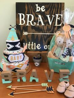 "Tribal ""Be brave little one"" gender neutral baby shower with arrows and feathers. Color theme: navy, peach, gold, mint"