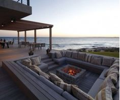 I need to be here right now, chilling, by the beach, fireplace, sofas