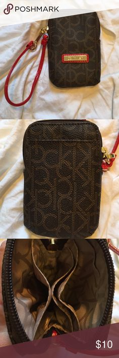 Calvin Klein Wristlet! Could hold IPhone lower than 6, according to case! Great if you have a flip phone!! :) Great Wristlet to throw some cards and cash in with a few necessities! Calvin Klein Bags Clutches & Wristlets