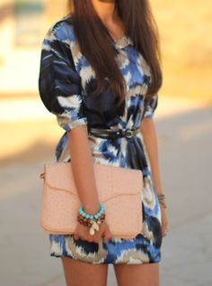Love the over-sized clutch & her watercolor dress.