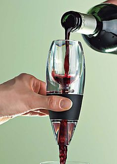 The Vinturi Red Wine Aerator. If you know that your clients are wine lovers - especially wine lovers - this is a great gift to give. Pair it with a great or Merlot. Vinturi Wine Aerator, Tequila, Wine Gadgets, Kitchen Gadgets, Champagne, Wine Reviews, Wine Refrigerator, Wine Parties, Gourmet