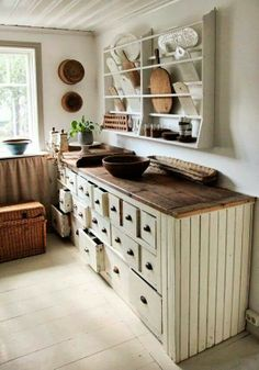 Farmhouse kitchen-I would add some more color, maybe granite countertops or slightly darker stained cabinets