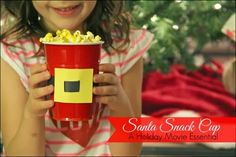 Santa Snack cups. We have been using these for weeks now! Perfect for family movie night or play dates. By Sugar Aunts.