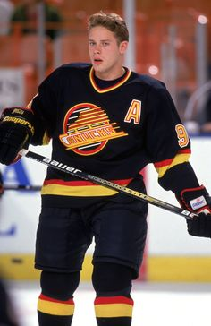 """Pavel Bure - Soviet and Russian hockey player, a graduate of the CSKA sports school. Honored Master of Sports. Spent 12 seasons in the NHL as part of teams, """"Vancouver Canucks"""", """"Florida Panthers"""" and """"New York Rangers"""" Hot Hockey Players, Ice Hockey Teams, Nhl Players, Hockey Mom, Nhl Wallpaper, Canada Hockey, Hockey Pictures, Pittsburgh Penguins Hockey, Vancouver Canucks"""
