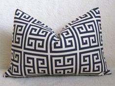 for center of navy sofa (with pottery barn ivory jute braid and sister parish paisley pillows)
