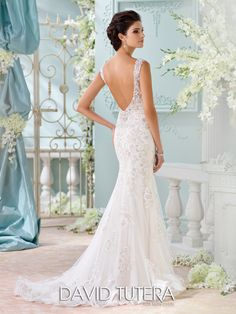 David Tutera for Mon Cheri - 116220 – Colesha - Backless wedding gown, sleeveless tulle, chiffon and embroidered metallic Schiffli lace appliqués over satin fit and flare dress with hand-beaded lace shoulder straps, hand-beaded sweetheart neckline, dropped waist, dramatic plunging V-back with covered buttons, lace and horsehair hemline with chapel length train.  Sizes:0 – 20,18W – 26W  Colors:Ivory/Light Gold, Ivory, White