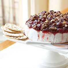 Warmed Cranberry Brie | Make an easy and elegant holiday appetizer by topping a round of baked Brie with sweetened cranberry sauce and toasted pecans. Serve with assorted crackers, gingersnaps, apple slices or pear slices.