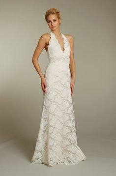 Jim Hjelm Fall 2011   This halter dress is the one I am leaning toward - my thoughts are if I went casual beachy it would work, and for more formal or more wintery, in a church, eg: I can find or have made a matching lace bolero to make it more modest.     Ivory lace modified mermaid wedding dress with embellished bridal sash