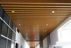 We offer a variety of styles and shades of wood grain, and the PRANCE brand's wood grain ceiling is clear and realistic. Both indoor and outdoor ceilings and walls of commercial buildings are suitable. Baffle Ceiling, Metal Ceiling, Ceiling Decor, Big Project, Visual Effects, Building Materials, Wood Grain, Blinds, Tube