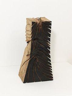 David Nash (British, b.1945)  Radial Crack/Cut Column  Part charred oak  h: 67 x w: 35 x d: 24 cm