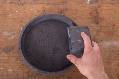 Learn how to make this round black concrete tray that looks like lava rock. No one will believe you made it yourself, but it's not difficult to DIY!