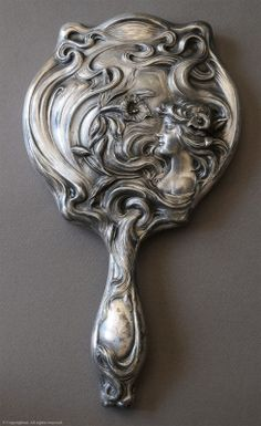 "An Art Nouveau mirror marked ""Derby Silver Co., Patented June… 1900, July 26, 1900"" The Derby Silver Company made silver plate flat and hollowware in Derby, Connecticut. They were one of the original companies that united to become the International Silver Company in 1898. They also used the name ""Derby Silver Plate Company"". This piece probably dates from 1900 to 1905."