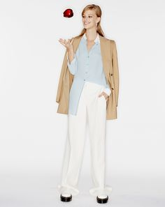 A blue silk button down is the ur-shirt. It should also be your shirt.Lexi Boling in aMichael Kors jacket and top, Dior pants, Erickson Beamon earrings, and Céline shoesMichael Kors contrast-trim silk blouse, $895michaelkors.com