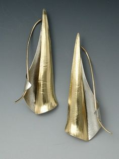 earrings by Betty Helen Longhi. Roll printed, formed and fabricated silver and gold bimetal.
