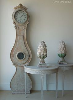 """""""This vignette features a pair of old painted wooden finials, small and elegantly carved Gustavian style demi-lune consoles, and a Swedish clock scraped to original paint."""" at Tone on Tone Swedish Decor, Swedish Style, Swedish Design, Scandinavian Style, French Style, Antique Interior, Wabi Sabi, Swedish Interiors, Vibeke Design"""