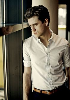 Aaron Tveit. The new Enjolras in Les Mis, out in December. Google him...his voice is beautiful.