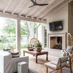 Covered Patio with White Brick Fireplace and Flatscreen TV