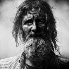A black and white portrait of a homeless person by Lee Jeffries