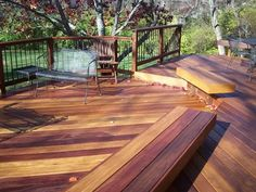 Cumaru tropical hardwood custom designed deck with Deckorator aluminum pickets in an Ipe rail, floating benches, and multi-levels in Centerville Ohio