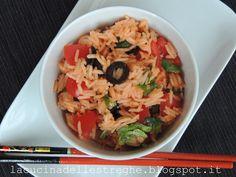 Insalata di riso basmati con rucola, pachino e olive nere