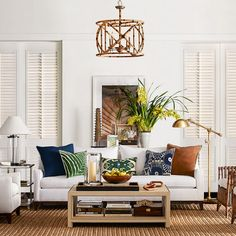 Bring the tropical outdoors in with an Island Style living room made up of woods, whites and accents of orange and blue.