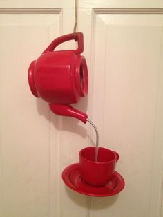 Re-purposed tea pot and cup into a bird feeder.