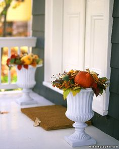 Autumnal Outdoor Bouquet | Martha Stewart Living - Showcase a sunset-hued medley of fall vegetables and foliage in decorative urns.