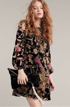 A moody floral print and lush burnout-velvet fabric conspire to make this ruffle-hem shift dress ideal for your next special event.