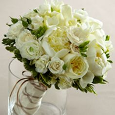 ftdW8-4623   Romance Eternal Bouquet: white ranunculus, roses, freesia, mini calla lilies, peonies, spray roses and hydrangea with lush greens. $272.99