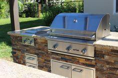 Outdoor Kitchen with ledgestone veneer and Delta Heat Appliances
