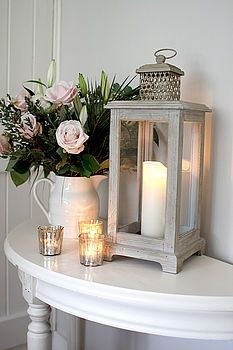 Small hallway decorating · grey storm lantern + candles but with other type of flowers - for centerpiece flat hallway Small Hallway Decorating, Storm Lantern, Entry Tables, Entrance Table, Grey Hallway, Long Hallway, Upstairs Hallway, Hallway Inspiration, Hallway Ideas