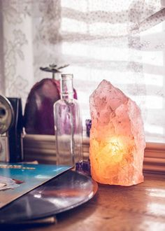 Love radiates from this gorgeous rose quartz lamp. Made with rough crystal, and fitted for a little light bulb. A perfect night-light! Rose quartz is known to promote unconditional love and friendship