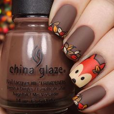 nails painted with a fox design art and autumn leaves