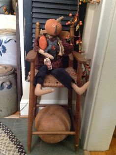 JOL doll in vintage high chair .