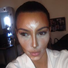 This is how Kim Kardashian's makeup artist, Scott Barnes, contours her face.  (Fyi: He sells his products online)