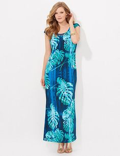 Our soft, stretch maxi has a graceful pattern that looks like rain falling through tropical leaves. Metallic rings peek through the fabric at the neckline to add subtle shine and embellishment. Bust darts. Catherines plus size dresses are expertly designed to flatter your figure. catherines.com