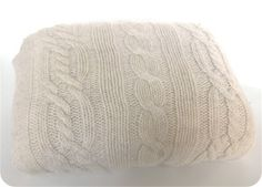 A sweater pillow is the perfect addition to a cozy living room.  Style and comfort.