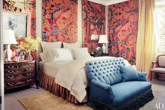 The Sevilla bedroom is enlivened by panels of 18th-century Spanish silk velvet at the Madrid home of Ambassador James Costos and his longtime partner, interior designer Michael S. Smith. | archdigest.com