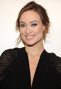 Pin for Later: Our Favorite Beauty-Savvy Stars Flock to the Tribeca Film Festival Olivia Wilde As a mom-to-be, Olivia isn't sticking to neutral makeup looks. At the Revlon concert for the Rainforest Fund, she rocked dark blue eye shadow.