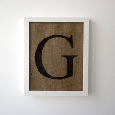 """G stenciled on burlap then framed. Could use a 'T' in our """"frame hallway"""""""