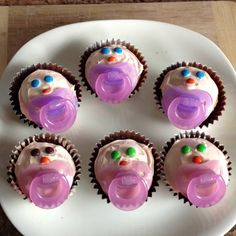 Cupcake babies, simple bake cupcakes make sure you only put 1/2 batter or they will overflow. Icing should be white with one drop red food color and 4 yellow. Use m's for eyes and nose and soother for mouth