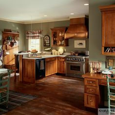 This open floor plan has a modern kitchen with rustic touches.