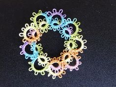 Rings around the Ring Wreath | Tatting Patterns - Another good beginner pattern that is lovely in Red or Green and attached to a Christmas Card if done in size 10 thread.