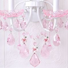 Inspired by centuries-old Fairy-tales fantasy and romance, this double-light wall sconce has been dressed to impress with LOADS of PINK crystal prisms and fancy-cut pink glass bobeches! Spectacular pink porcelain roses in full bloom make this sconce a true vision in pink, elegant, sparkly and undeniably dreamy… <BR><BR>Complete the look with our wonderful pink rose-shades and check our collection for a matching 5 light rose chandelier, as well as a matching rose-bouquet table lamp! <br><br…