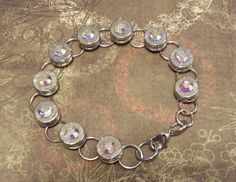 Winchester bullet tennis bracelet with Clear AB swarovski crystal gems. More calibers, head stamps and swarovski colors available at AdornmentsByValerie.etsy.com   Check out this item in my Etsy shop https://www.etsy.com/listing/246938726/bullet-bracelettennis-braceletwin-9mm