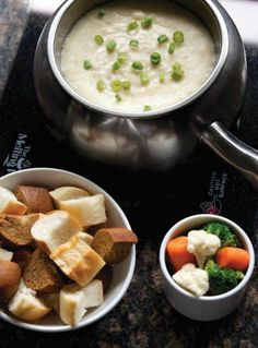 "Traditional Swiss Fondue & Bourbon Bacon Cheddar Fondue  --  Recipes from ""The Melting Pot Cookbook"""