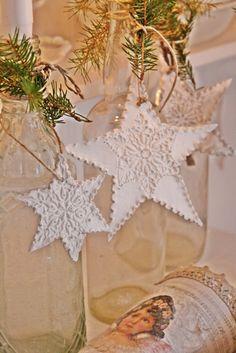 White stars around embellished bottle candle holders