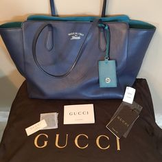 AUTHENTIC GORGEOUS GUCCI SWING TOTE! Great bag, nice and big!!!  Beautiful navy blue and turquoise leather with linen lining.  Outside is in perfect condition inside light wear, some  marks.  Comes with all tags, authenticity proof and dustbag. Also on M for $640 Gucci Bags Totes