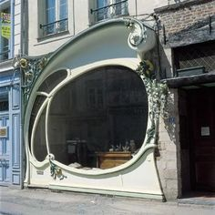 Art nouveau shapes are clear in this shop front